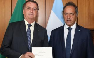 El presidente brasilero Jair Bolsonaro y Daniel Scioli en un encuentro anterior.