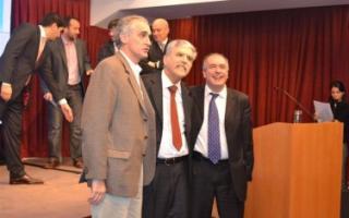 Popovich, junto a De Vido y López.