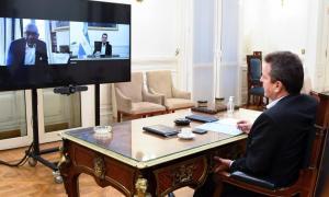 Massa en videoconferencia con Meeks, en abril.