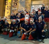 """Navidad en Luján: Los Bomberos se subieron a """"trineo"""" y recorrieron centro, barrios y el Hospital"""